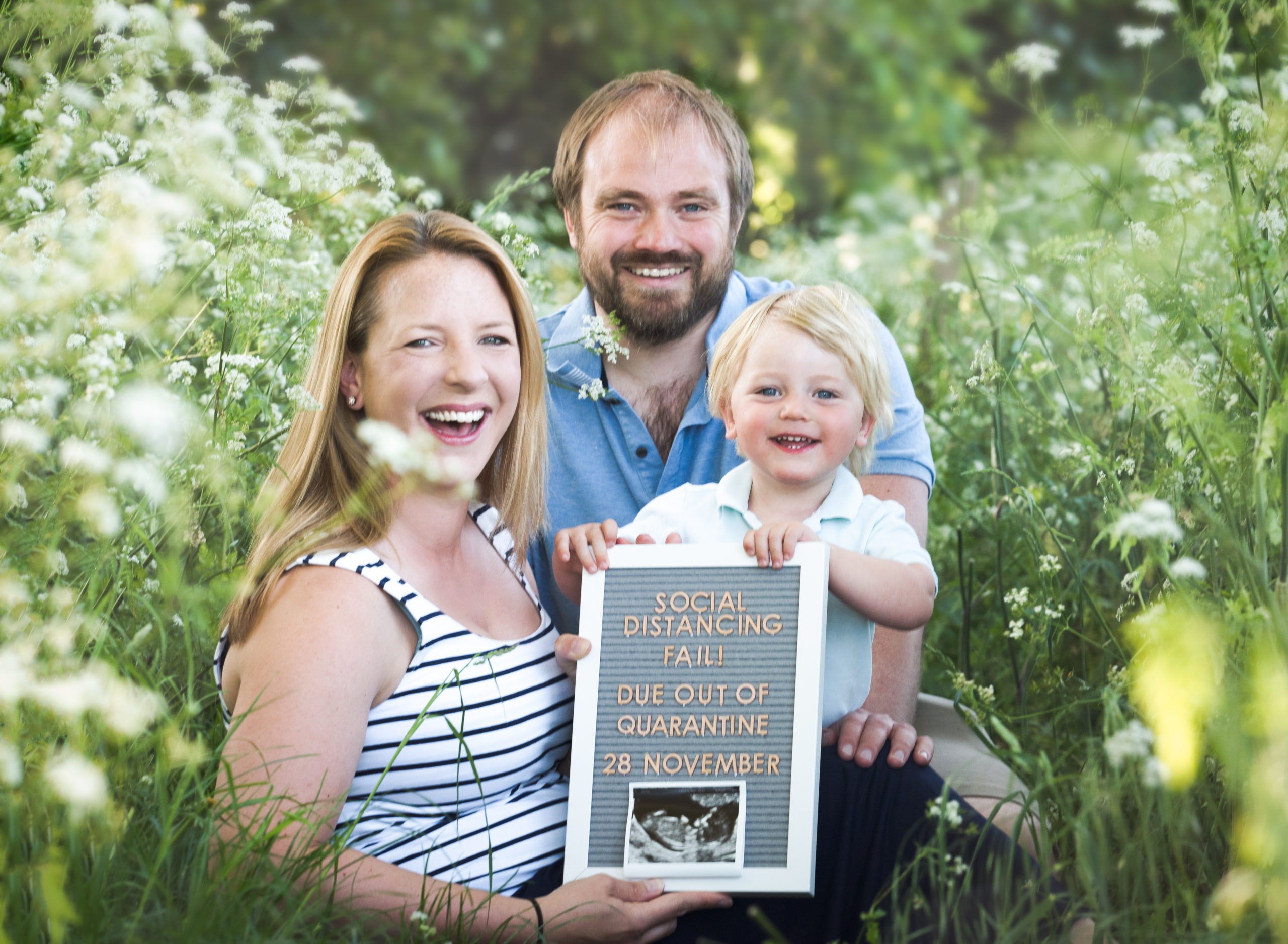Family sit amongst cow parsley for pregnancy reveal in Wallingford Photoshoot
