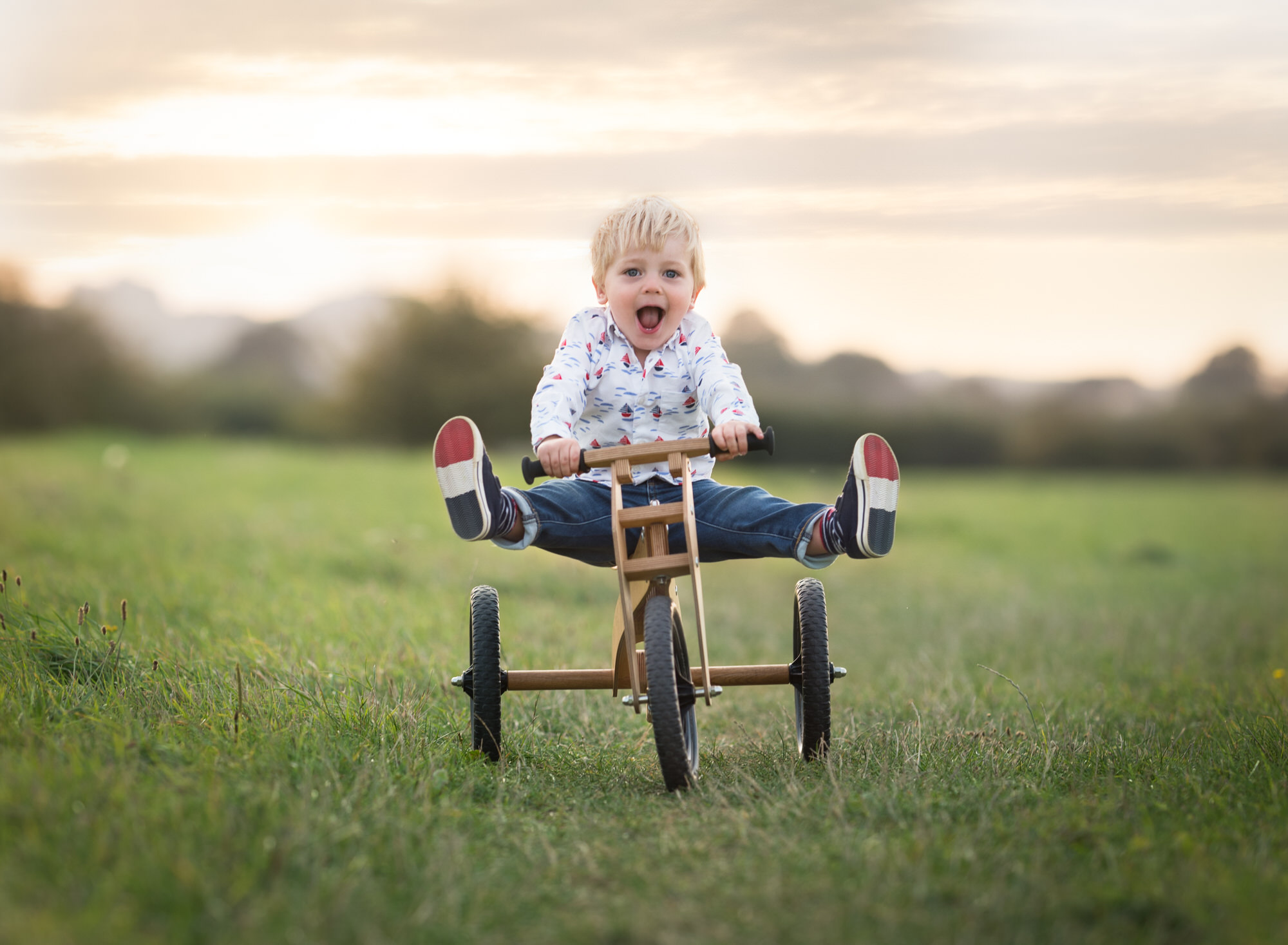 Toddler on a bike with legs up on photoshoot in Oxford