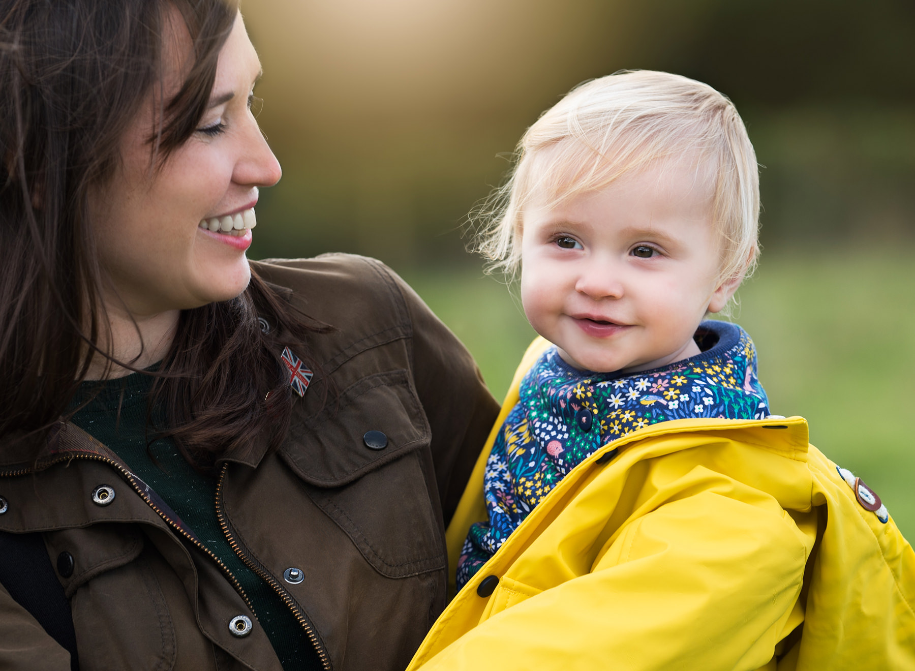 Mother looking lovingly at her baby during photoshoot in Benson