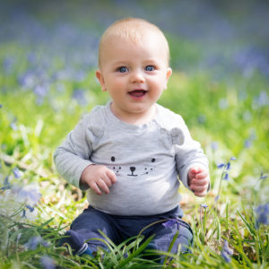 Baby sat amongst the bluebells during spring photoshoot in Wallingford